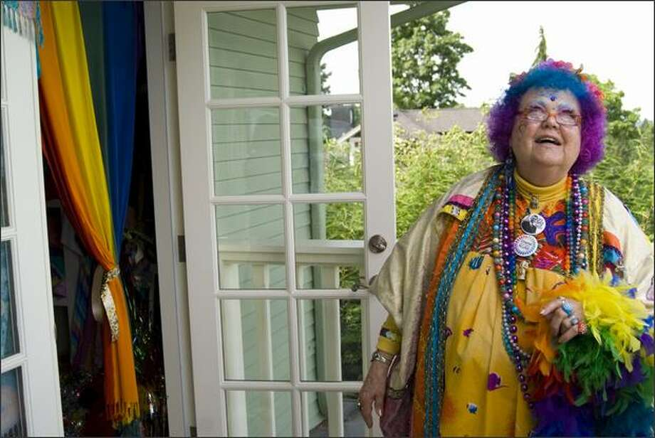 Dee Dee Rainbow, better known as the Rainbow Lady, checks out the skies above her Madrona home. Her clothes show her world view. Photo: Andrew Phan/Special To The P-I