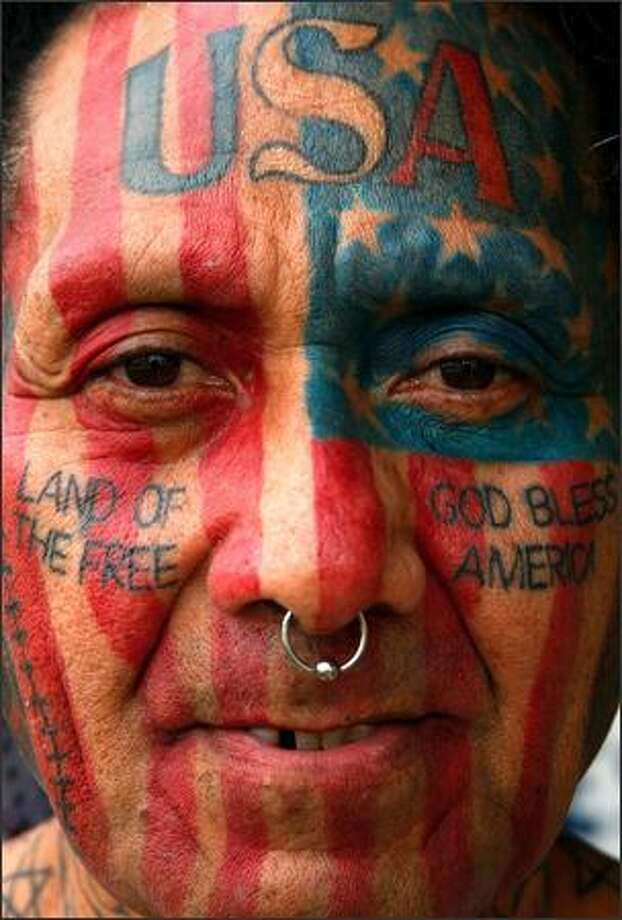 Sam Bloomfield has a tattoo of the American flag on his face. Photo: / Associated Press