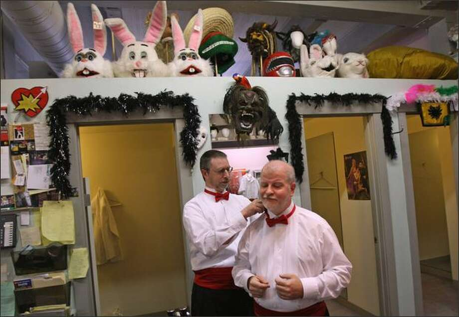 Ken Molsberry, left, helps partner Chris Vincent, both of West Seattle, with his bowtieduring a fitting at Brocklind's, a formal wear shop in Seattle's First Hill neighboorhood. The couple are planning a trip to San Francisco to get married. They weremarried there in 2004 also. Photo: Mike Kane/Seattle Post-Intelligencer
