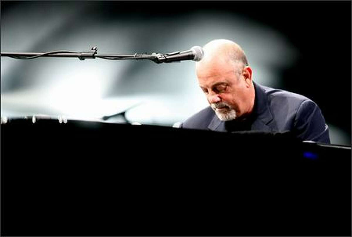 The Piano Man, Billy Joel, plays Key Arena in Seattle, Thursday.