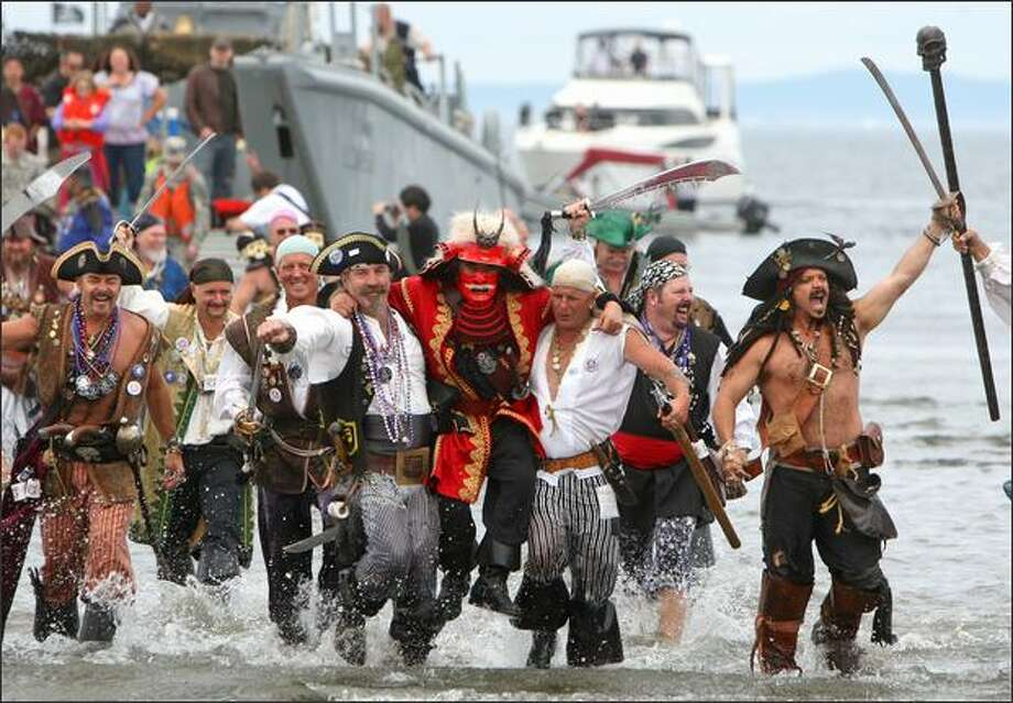 The rowdy Seafair Pirates storm Alki Beach in West Seattle to mark the beginning of Seafair on Saturday. Photo: Mike Kane/Seattle Post-Intelligencer