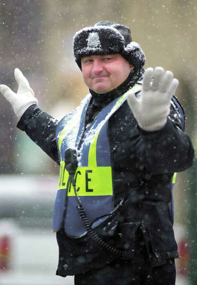 In this January 2002 file photo, Greenwich Police Officer James Genovese directs traffic at the Intersection of Greenwich Avenue and Elm Street. Greenwich police are mourning the loss of one of their own after veteran officer Genovese died suddenly in the Westchester County (N.Y.) Medical Center Tuesday night. Genovese, who became a staple of Greenwich Avenue, where he was often seen directing traffic, was 44. He was off duty at the time of his death. Photo: File Photo / Greenwich Time File Photo