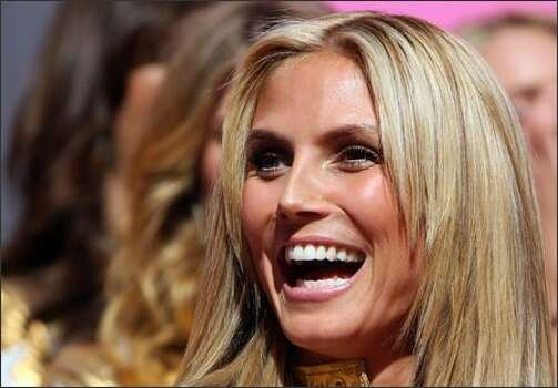 Victoria's Secret Angel German Heidi Klum poses on the Hollywood Walk of Fame after being honored by a star in front of the Kodak Theater on Hollywood Boulevard to celebrate the 25th anniversary of Victoria's Secret 13 November 2007 in Hollywood, Calif. Photo: Getty Images