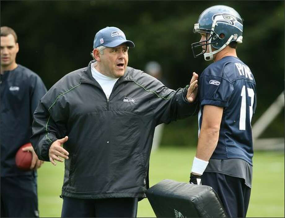 Wide receivers coach Keith Gilbertson works with Logan Payne during minicamp at the Seahawks practice facility in Kirkland last month. Photo: Dan DeLong/Seattle Post-Intelligencer