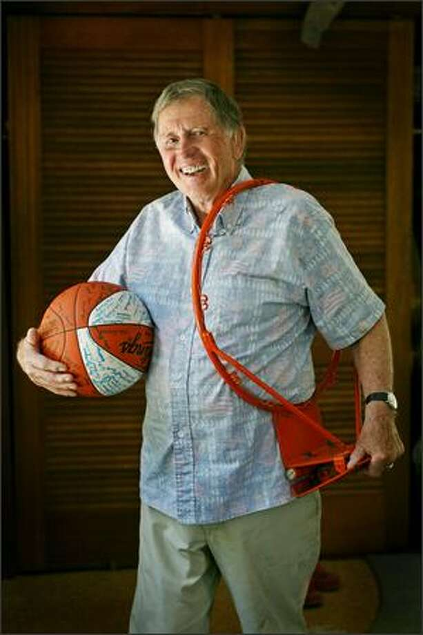 NOW: Chuck Randall shows off his collapsible basketball rim last week at his Bellingham home. He has little to show for it. Photo: Dan DeLong/Seattle Post-Intelligencer