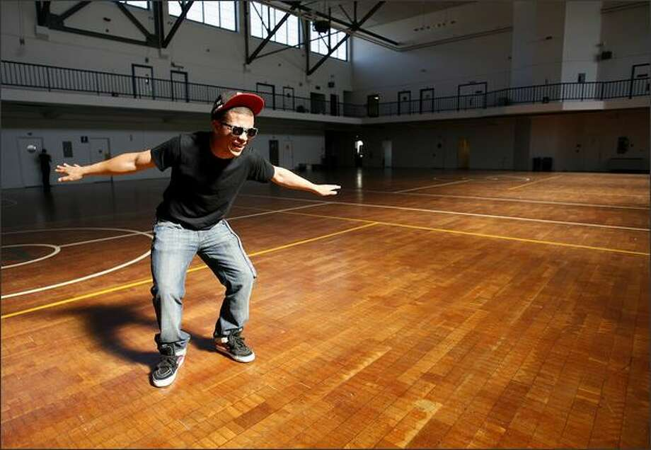 Cliff Sheckles, 16, performs a dance known as the thizzle at the Armory Building at South Lake Union, where he hosted a private dance for 1,280 high school students. Photo: Kristine Paulsen/Seattle Post-Intelligencer