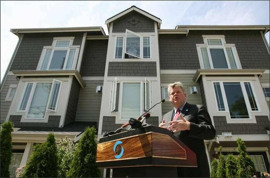 Standing Tuesday outside townhouses on Capitol Hill, Mayor Greg Nickels announces the first major changes to Seattle's multifamily zoning in 20 years. Nickels also proposed new rules and a design review for all new townhouses being built throughout the city. Photo: Dan DeLong/Seattle Post-Intelligencer