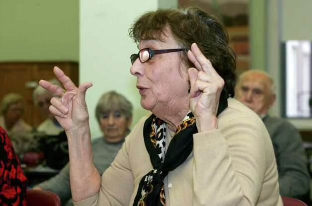 Marion Kochka asks a question about wolves during Wednesday mornings visit to the Greenwich Senior Center of Atka, an Arctic grey wolf from the Wolf Conservation Center in South Salem, N.Y.  March 23, 2011 Photo: David Ames, David Ames/For Greenwich Time / Greenwich Time Freelance