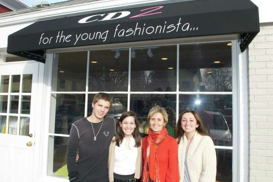 From left to right: Brett Atkinson, Catherine Bisanzo, Ellen Atkinson, and Stephanie illescas of Consign Design's two shops. Photo: John Ferris Robben Photo: Contributed Photo / Greenwich Time Contributed