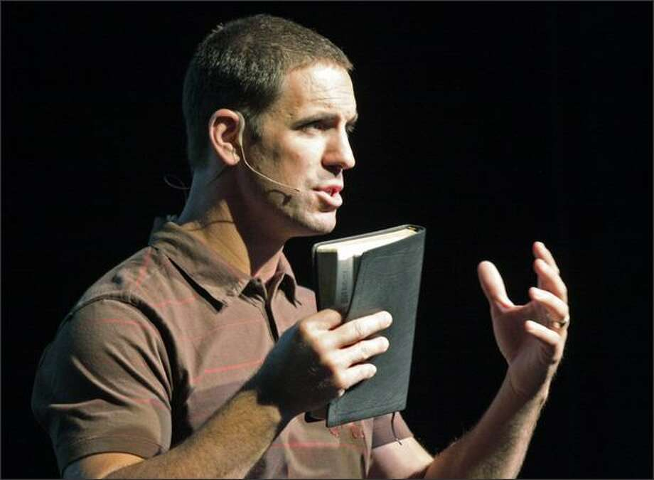 Pastor Jesse Winkler leads a service at the new Mars Hill Church in Bellevue on Sunday. Photo: Dan DeLong/Seattle Post-Intelligencer