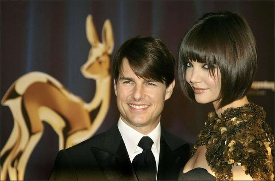 US actor Tom Cruise and his wife Katie Holmes pose on the red carpet before attending the Bambi media prize awards ceremony, 29 November 2007 in Dusseldorf. The awards ceremony takes place every year under the patronage of German publisher Hubert Burda and awards nominees in the sectors of communication, entertainment and show business as well as economy, politics and sports. Photo: Getty Images