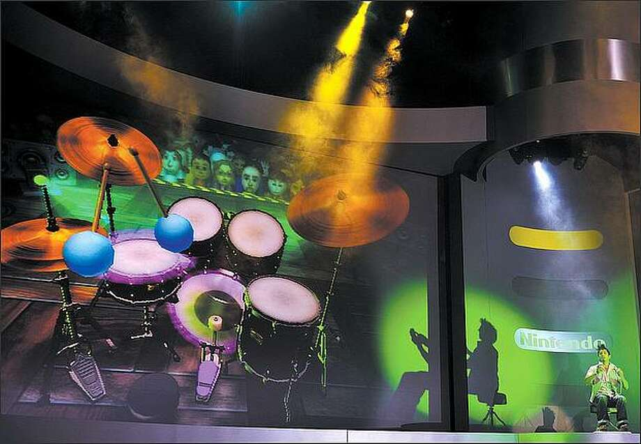 "A professional drummer demonstrates the new ""Wii Music"" by playing virtual drums during the Nintendo E3 media briefing at the Kodak Theater in Hollywood on Tuesday. Photo: / Getty Images"