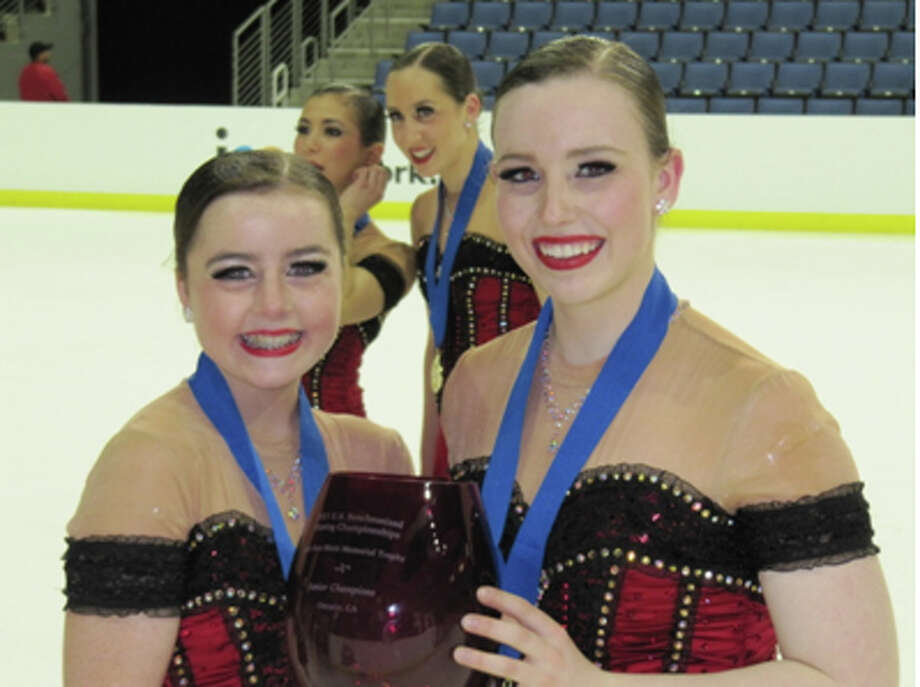 Mairead Brock and Brooke Abbott holding the National Cup in California. Photo: Contributed Photo / Stamford Advocate Contributed