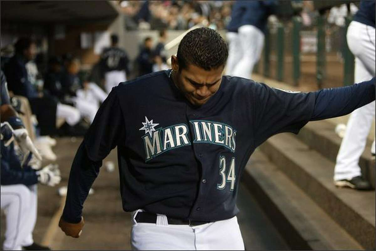 Felix Hernandez, showing his frustration after giving up a home run in a win over the Angels on April 11, is one of the few bright spots for the Mariners.