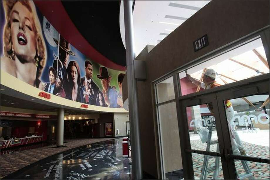 "The entryway of AMC's new 16-screen cinema is etched with famous movie lines such as ""They Call Me Mr. Tibbs!"" and ""Go Ahead, Make My Day."" Photo: Meryl Schenker/Seattle Post-Intelligencer"