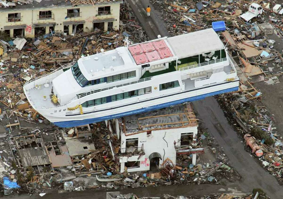 A sightseeing boat washed away by the March 11 tsunami sits on a ruined building in Otsuchi, Iwate Prefecture, Japan, Wednesday March 23, 2011. (AP Photo/Kyodo News) JAPAN OUT, MANDATORY CREDIT, NO LICENSING IN CHINA, HONG KONG, JAPAN, SOUTH KOREA AND FRANCE