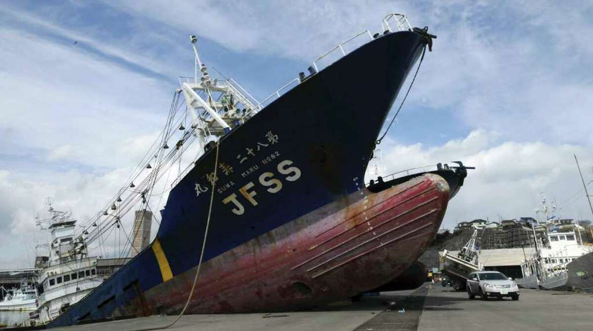 A ship is left washed ashore following the March 23, 2011 earthquake and tsunami in a pier at Onahama port in Iwaki, Fukushima Prefecture, northeastern Japan, Wednesday, March 23, 2011. (AP Photo/Yomiuri Shimbun, Satoshi Oga) JAPAN OUT, MANDATORY CREDIT