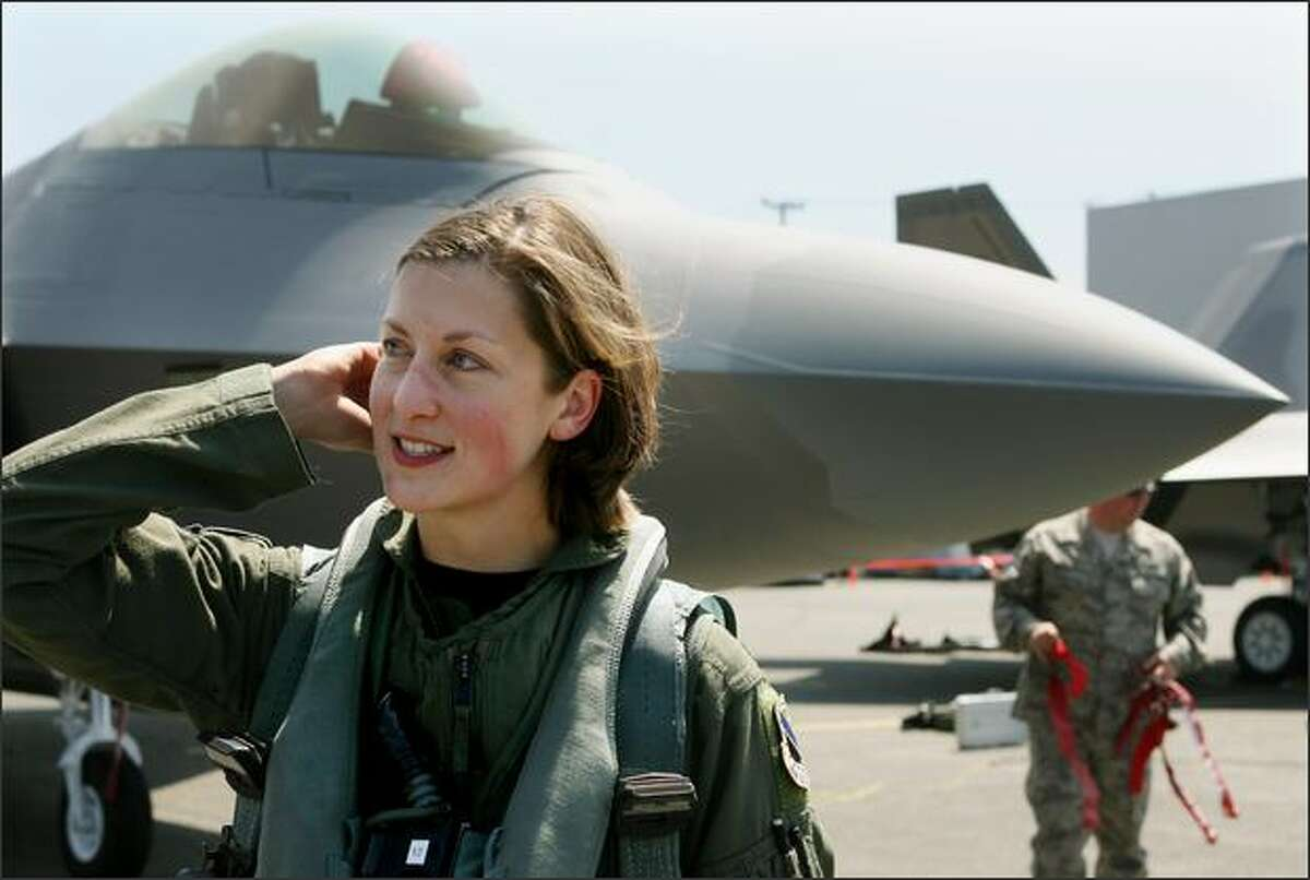 Capt. Jammie Jamieson, at Boeing Field on Thursday, was the first female fighter pilot to qualify in the F-22A Raptor. Two F-22s, the nation's newest fighter jet, will be at the McChord Air Show.