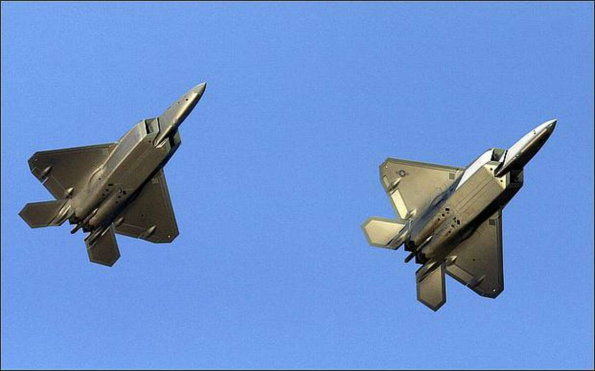 Two F-22A Raptors, one piloted by Capt. Jammie Jamieson, fly over Seattle before landing at Boeing Field on Thursday.