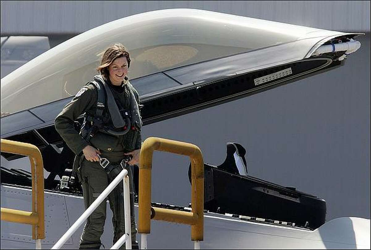 Jamieson exits the Raptor's cockpit after the flight. Jamieson, formerly of Prosser, sees herself as a fighter pilot and officer, period: