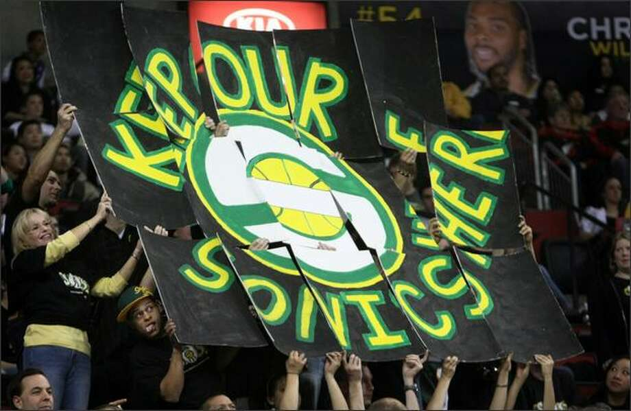 During a game against the Portland Trail Blazers on March 24, Sonics fans show support for keeping the team in Seattle. Photo: Joshua Trujillo/Seattle Post-Intelligencer