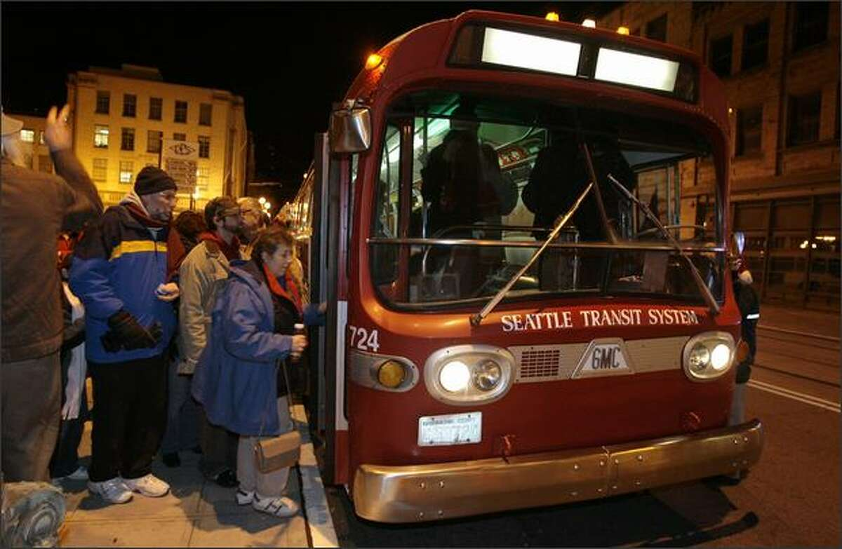 Passengers board a 1968 General Motors coach originally operated by Metropolitan Transit System for the MEHVA (Metro Employees Historic Vehicle Association) annual Santa Lights Bus Tour in Seattle on Saturday December 8, 2007. The tour consisted of a 2.5-hour bus tour of Seattle's best Christmas lights on board a fleet of King County's historic buses.