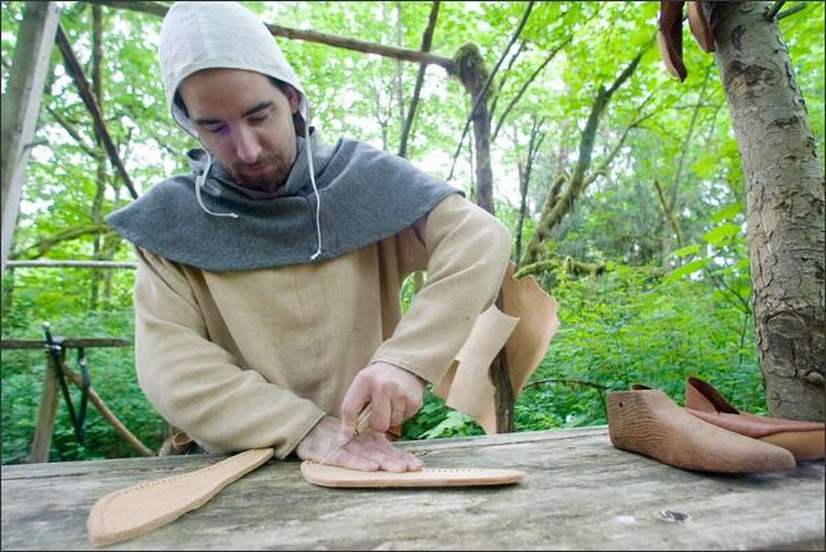 Nicholas the shoemaker practices his trade at Camlann.