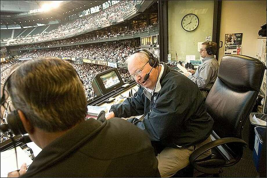 Veteran broadcaster Dave Niehaus talks with co-announcer Rick Rizzs, left, at Safeco Field. Niehaus has broadcasted 4,912 games during his 32 years with the Mariners. Photo: Grant M. Haller/Seattle Post-Intelligencer