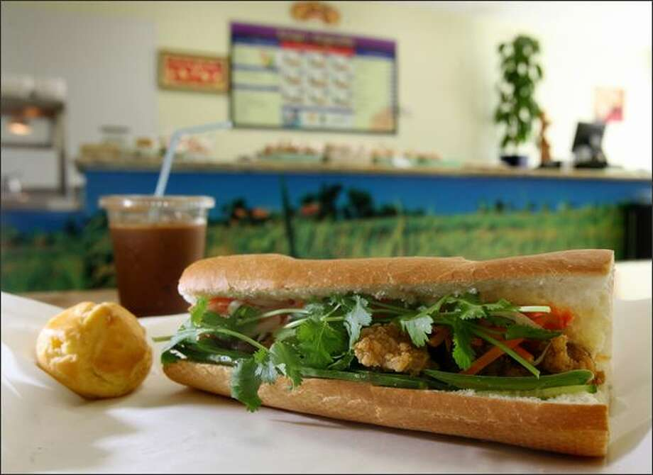 Rainier Valley upstart King Baguette serves banh mi with a twist -- crisp chicken. This Vietnamese sandwich sells for $2.60. Photo: Dan DeLong/Seattle Post-Intelligencer