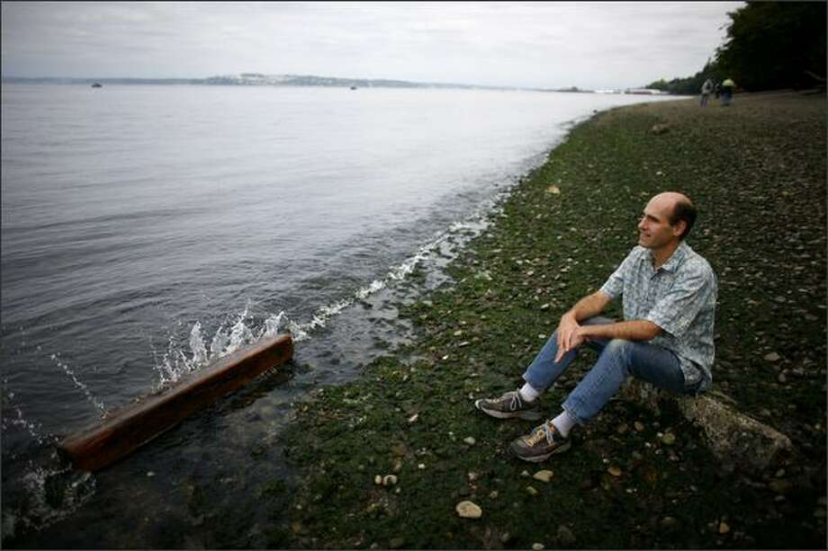 Dave Batker, an economist and the director of the nonprofit think tank Earth Economics, looks over the water at Tacoma's Point Defiance Park on Wednesday. Photo: Joshua Trujillo/Seattle Post-Intelligencer