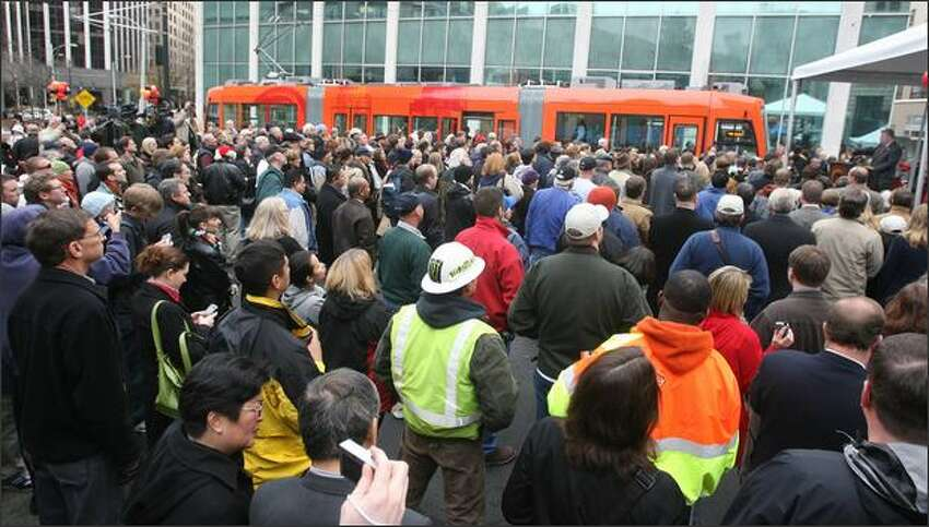 The Seattle Streetcar began its operations in Seattle. Mayor Greg Nickels hosted a ceremony starting at 11:30 a.m. and the first streetcar embarked from the Westlake Hub at 12:12 p.m.