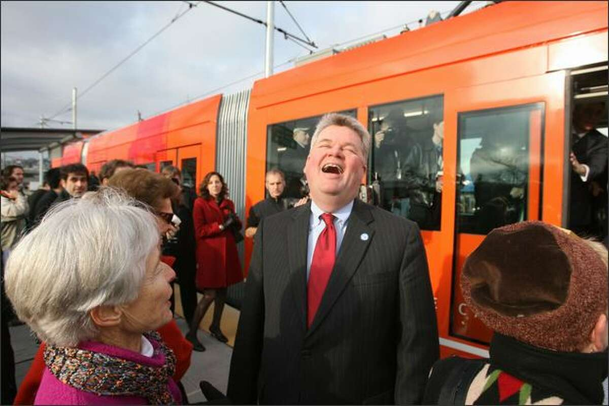Seattle Mayor Greg Nickels hosted a ceremony starting at 11:30 a.m. and the first streetcar embarked from the Westlake Hub at 12:12 p.m. Nickels enjoys the day as he visits with commuters at one of the Lake Union stops.