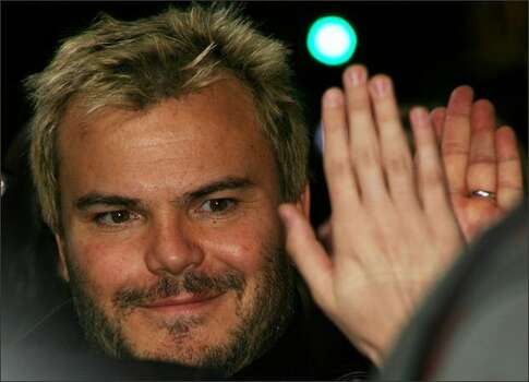 "Actor Jack Black gives a fan a ""high five"" during the ""Walk Hard: The Dewey Cox Story"" film premiere at Grauman's Chinese Theatre on Wednesday in Hollywood, Calif. Photo: Getty Images"