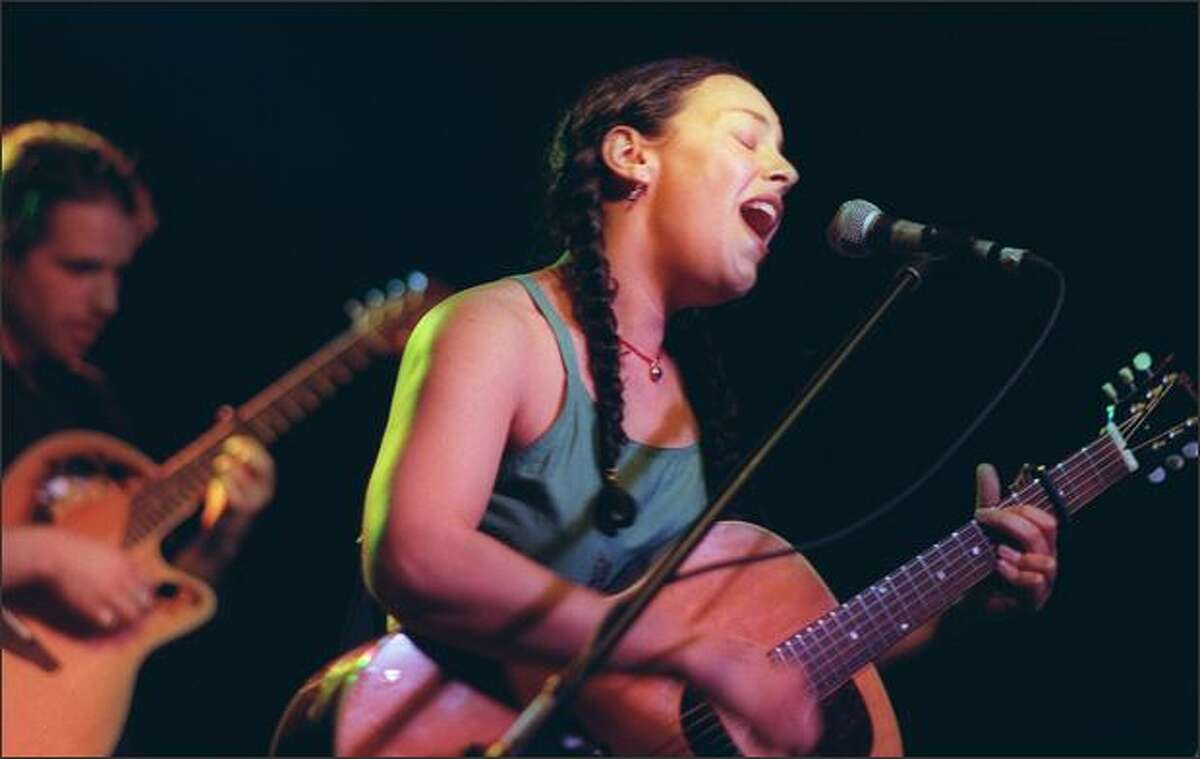 Jill Cohn belts out her tune at the Crocodile Cafe in this May 18, 1999 file photo as she preforms to try and win a spot at Lilith Fair.