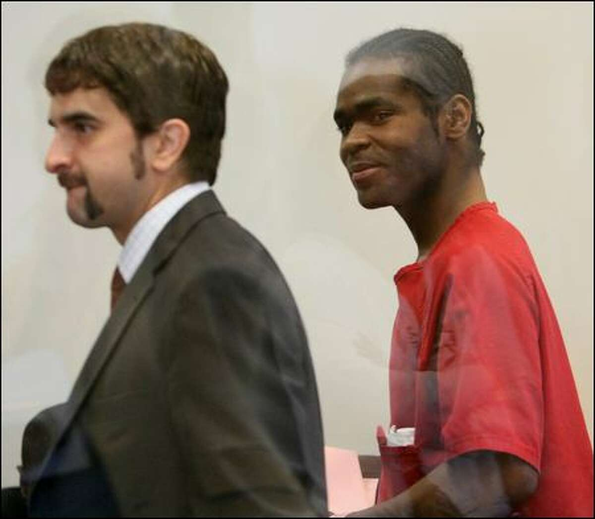 King County public defender Carlos Gonzales, pictured in 2008 with murder defendant Brian Keith Brown. Brown killed Seattle resident James Paroline with a single punch during an argument. The unintentional slaying prompted public outrage, but was ultimately resolved with Brown pleading guilty to second-degree murder in an agreement meant to align his prison sentence with the punishment for manslaughter.