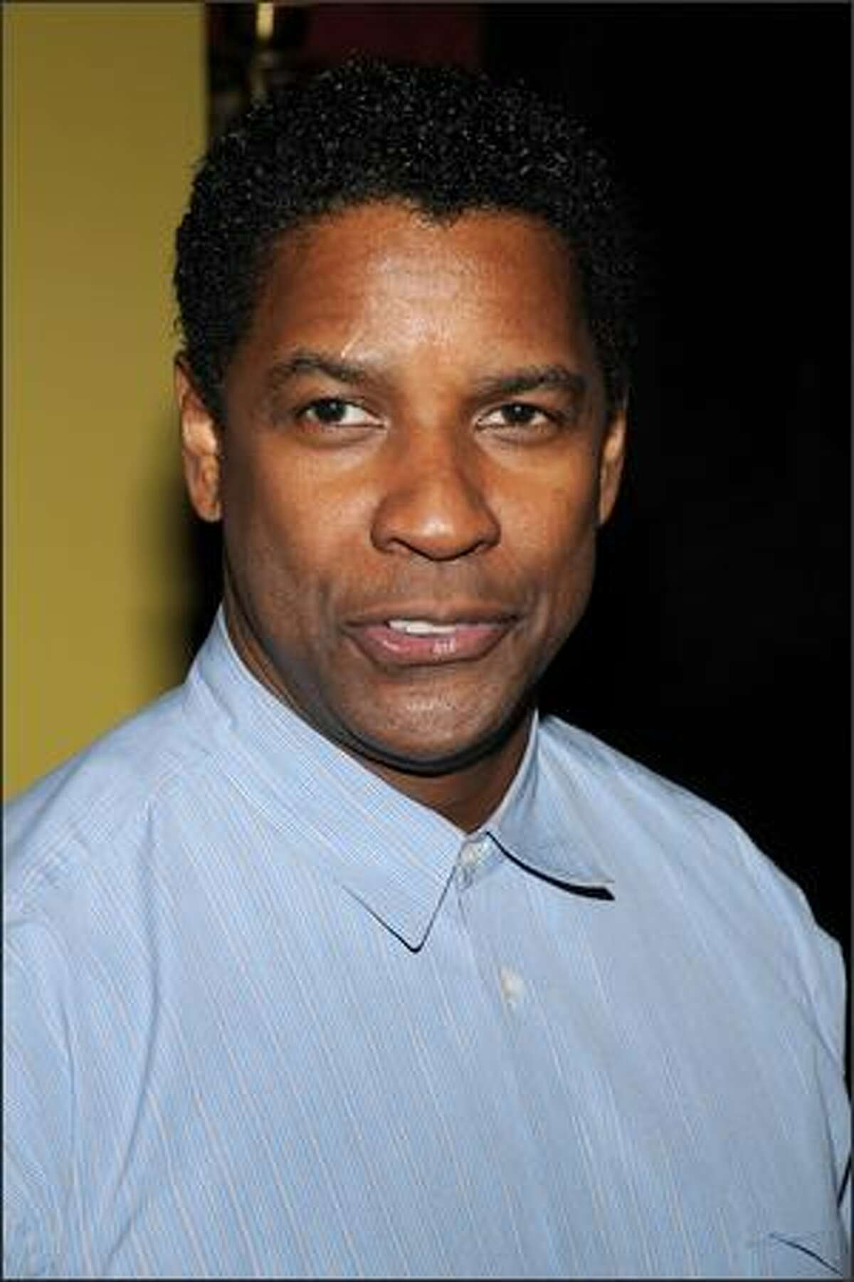 Actor/director Denzel Washington arrives at the premiere of his film