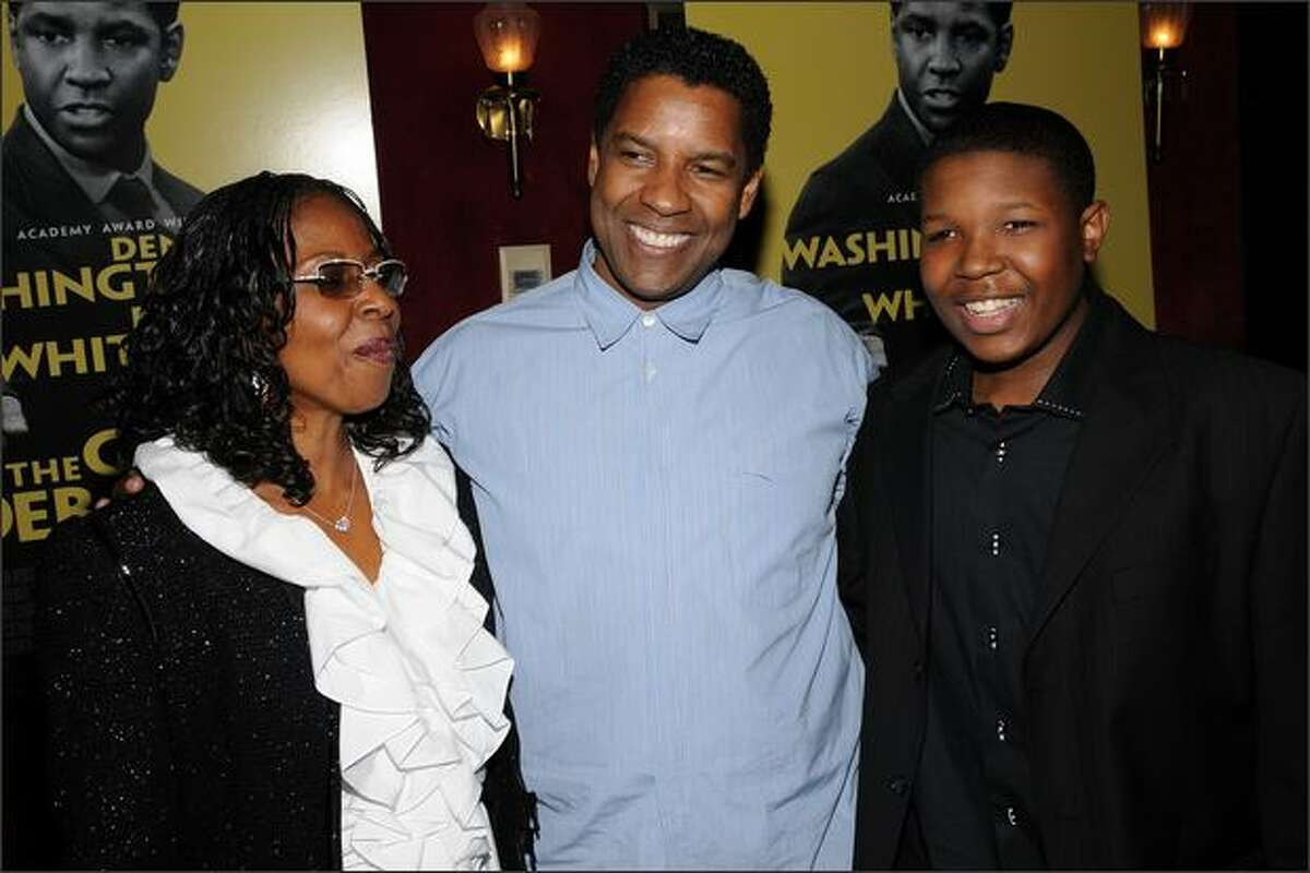 Denzel Washington (center), his wife Pauletta Parson and actor Denzel Whitaker, who has a part in the film, arrive.