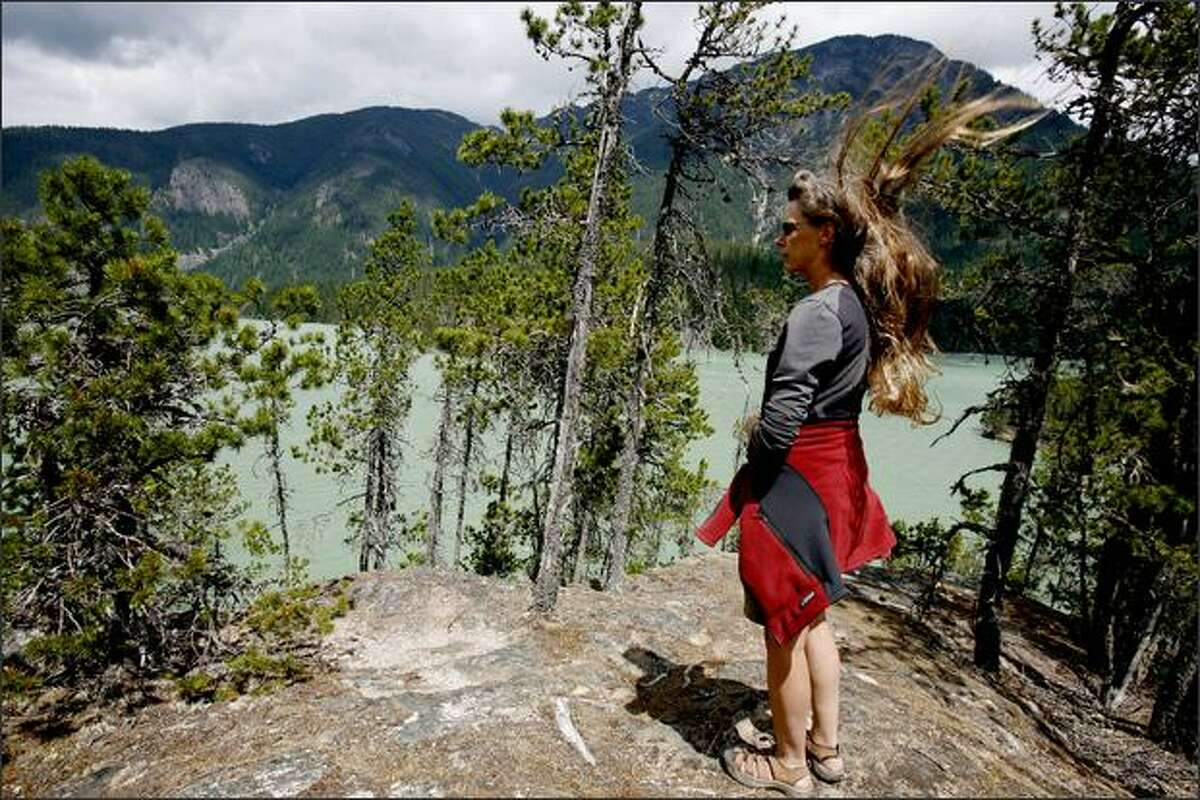 Lorna Johnston takes in the view on a typical -- that is, windy -- afternoon at Diablo Lake.