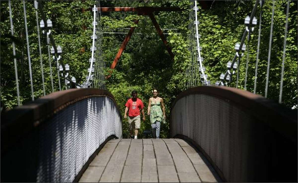 From Main Street, a suspension bridge over the Skagit River leads Jonathan and Christel Henson of Port Townsend to the half-mile-long Trail of the Cedars.