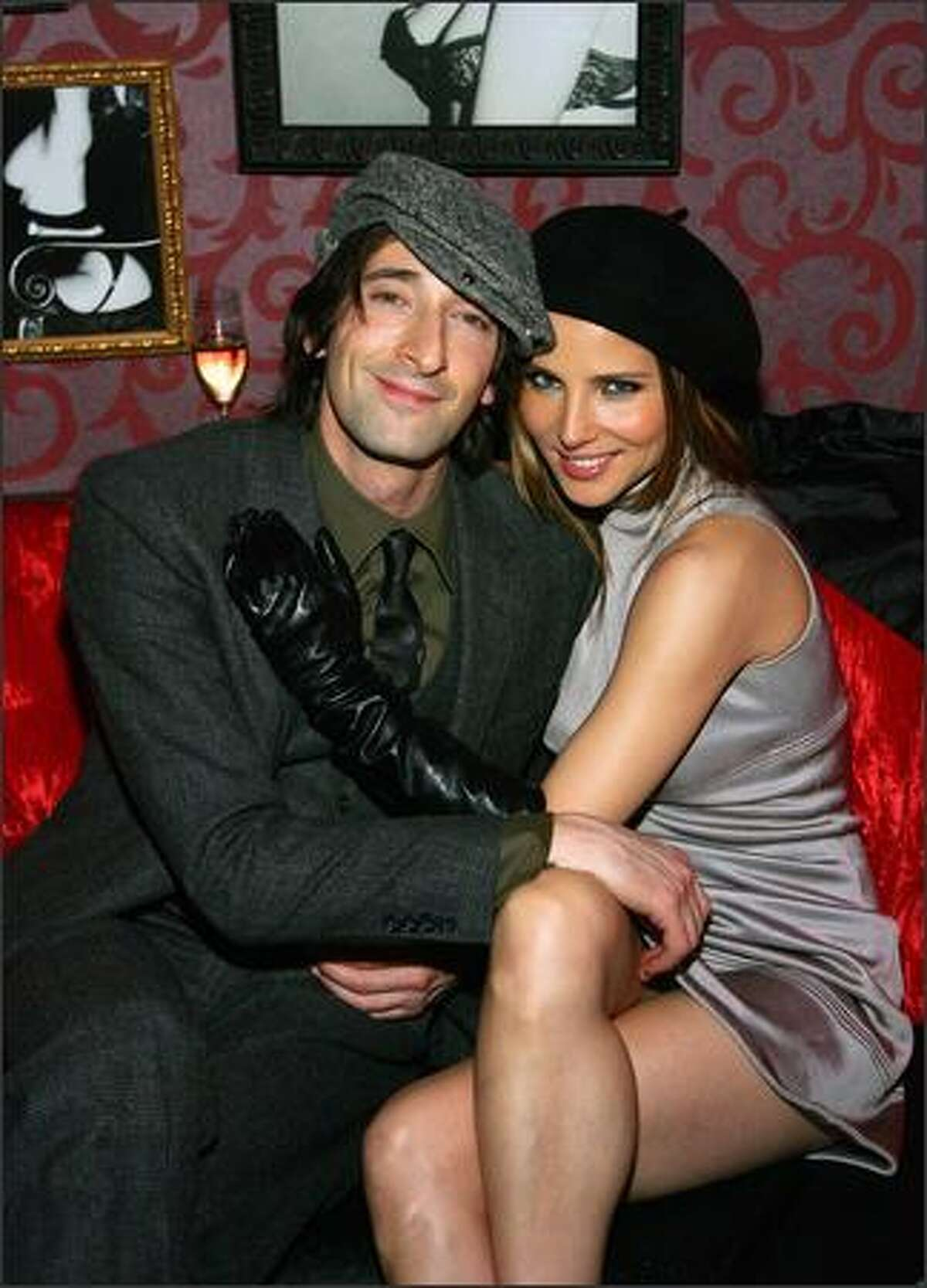 Actor Adrien Brody (L) and actress Elsa Pataky pose at the grand opening of the CatHouse at the Luxor Resort & Casino in Las Vegas, Nevada.
