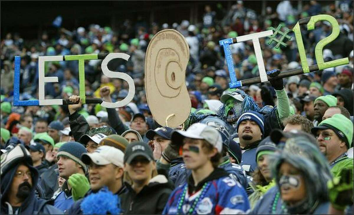 Seahawks fans boost the decibel levels at Qwest Field as the Seahawks play the Washington Redskins in the third quarter.