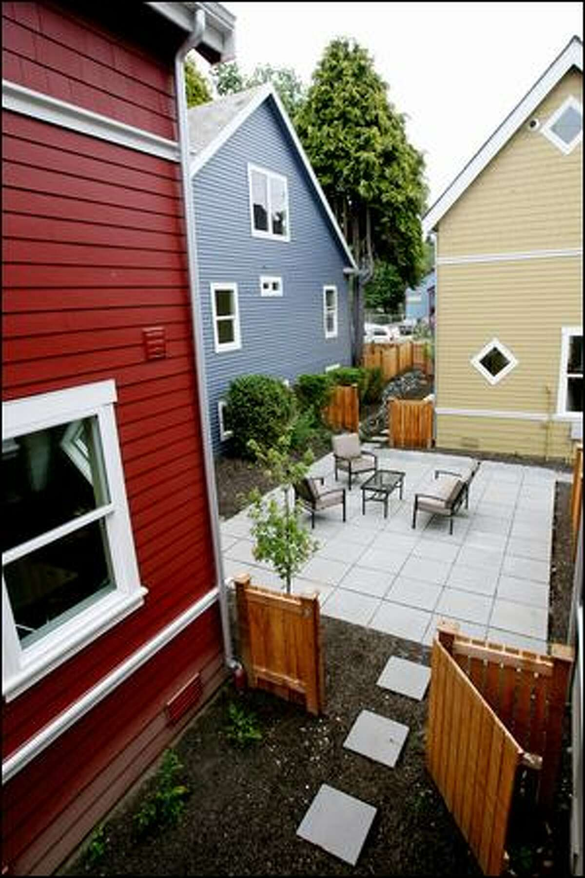 The Brandon Street cottages in West Seattle encircle a central courtyard and are priced at about $300,000. But these aren't the area's first. Similar homes have also been built in Redmond and Kirkland, for instance.
