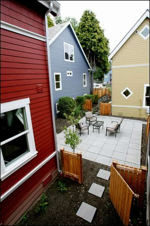 The Brandon Street cottages in West Seattle encircle a central courtyard and are priced at about $300,000. But these aren't the area's first. Similar homes have also been built in Redmond and Kirkland, for instance. Photo: Dan DeLong/Seattle Post-Intelligencer