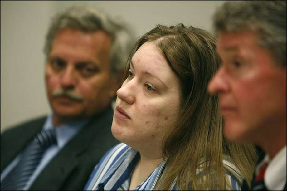 Michele Anderson, center, listen to pretrial proceedings in King County Superior Court, where a judge ruled Thursday that prosecutors can wait until September before deciding whether to seek the death penalty if the two are convicted of murder. Photo: Paul Joseph Brown/Seattle Post-Intelligencer