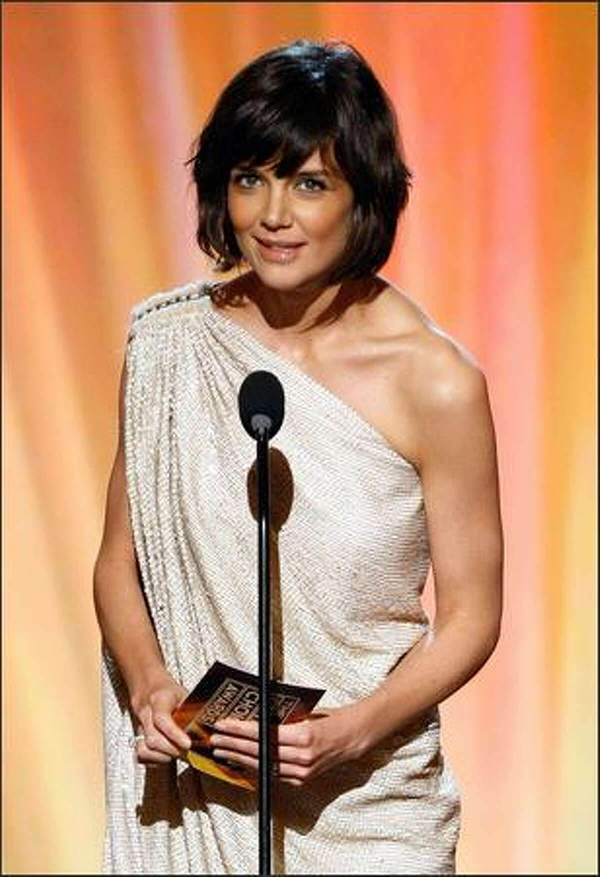 Actress Katie Holmes presents the Comedy Movie Award onstage during the 13th annual Critics' Choice Awards held at the Santa Monica Civic Auditorium on Monday in Santa Monica, Calif.