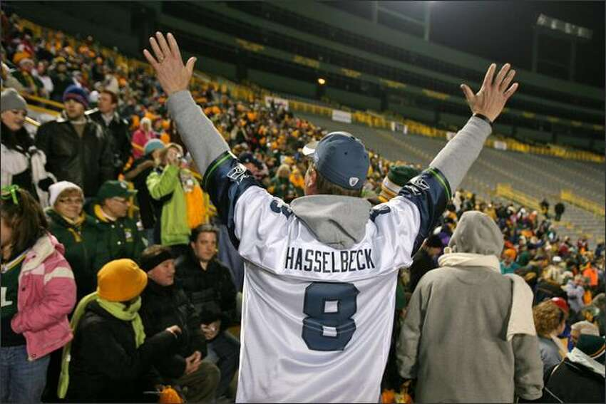 A daring Glen Kanenwisher, a Boeing manager from Seattle, introduces himself to the crowd wearing a Matt Hasselbeck jersey during a Packers pep rally at Lambeau Filed in Green Bay, Wisconsin.