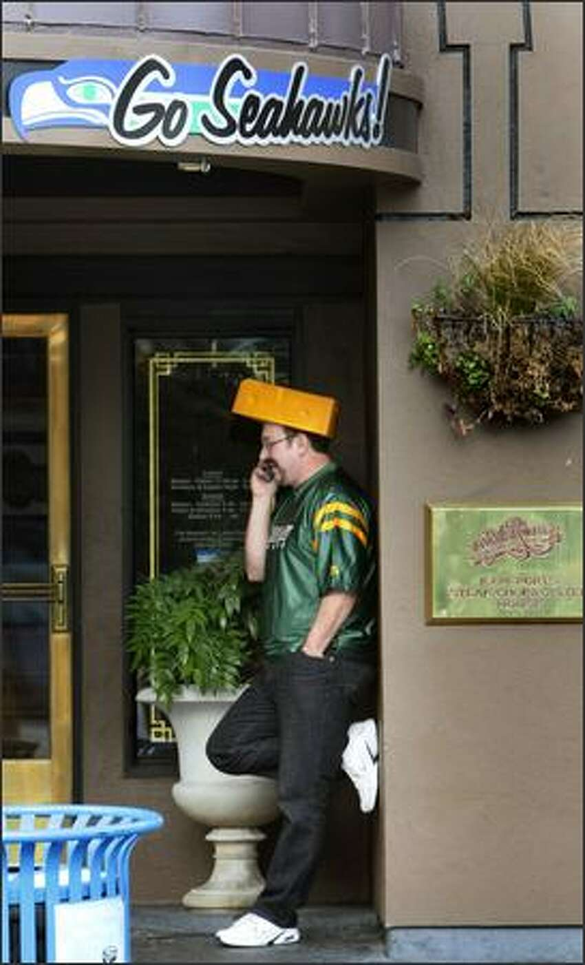 Green Bay fan Steve Nyberg talks on his phone at F.X. McRory's Whiskey Bar near Qwest Field in Seattle after his team pulled ahead of the Seahawks.