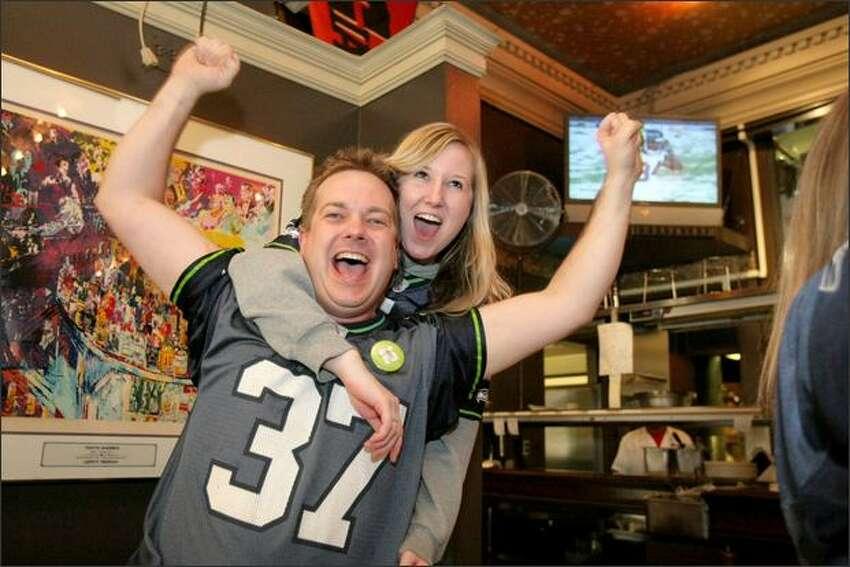 Dean Lovitt and Hillary Brocenos cheer on the Hawks at F.X. McRory's.