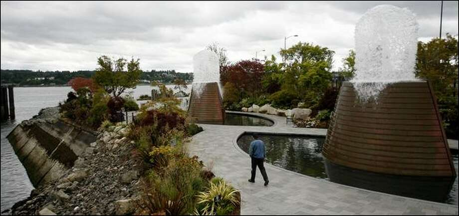 Harborside Fountain Park in Bremerton occupies 1.7 acres along the water and shows off copper-clad fountains meant to represent both submarines and whales. Photo: Kristine Paulsen/Seattle Post-Intelligencer