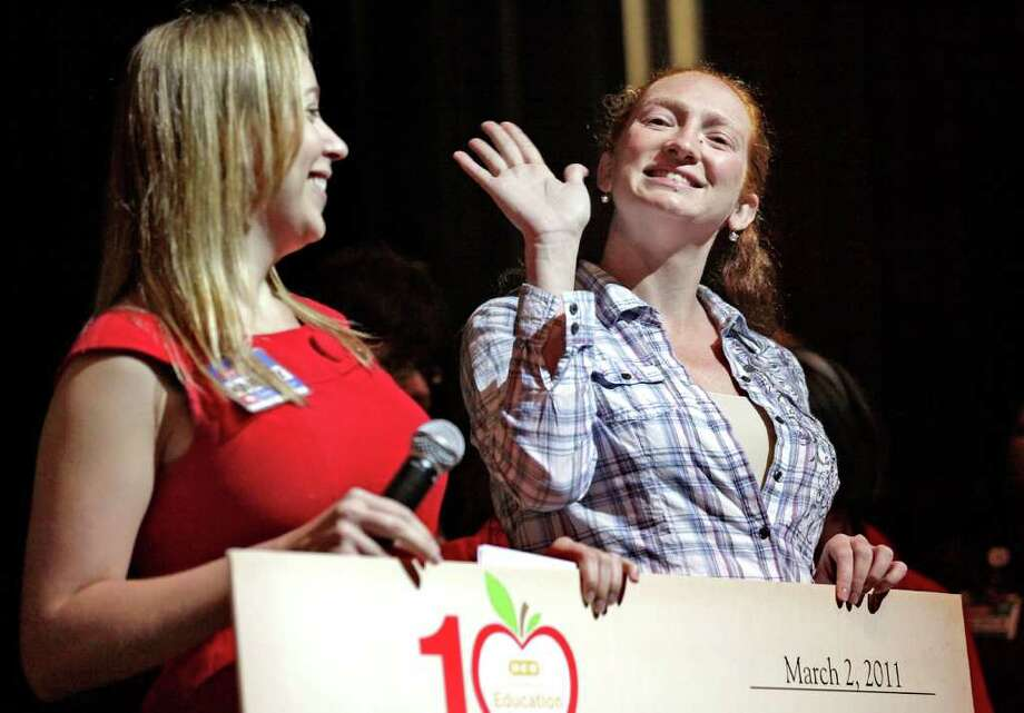Lee High School teacher Penny McCool (right) is all smiles after the announcement that she's a finalist in the H-E-B Excellence in Education Awards. Kim Harle (left) of H-E-B presents the check. Photo: Bob Owen/Express-News / rowen@express-news.net